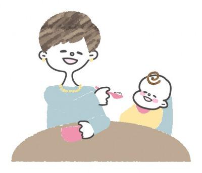赤ちゃんに離乳食をあげるママ